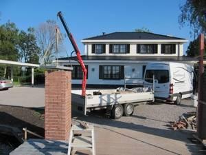 Dichte, houten, luxe poort met ondergrondse poortopener - Farm Poorten